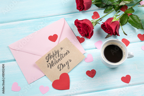 Valentine day. Top view of roses, hearts, gifts, coffee and envelope