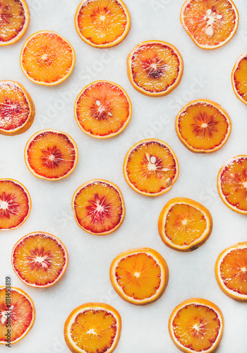 Natural fruit pattern concept. Fresh juicy blood orange slices over light marble table background, top view - 181453819
