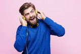 Man with headphones singing - 181455043