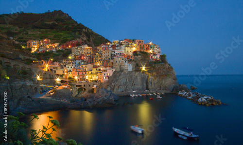 Foto op Canvas Liguria Manarola, Liguria, Italy. Beautiful wonderful village as you can see it from the mountain above. Quiet sky and peaceful sea, during sunset background.