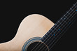 acoustic guitar & beautiful rim light of six strings, frets and body shape, isolated on black for music background