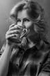 Beautiful girl with coffee mug .