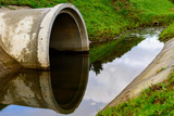 Concrete culvert pipe hole system draining sewage water. Environmental disaster - 181461669