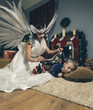 Woman with angel wings and sleeping boy .