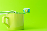 Toothbrush with toothpaste and green mug - 181471232