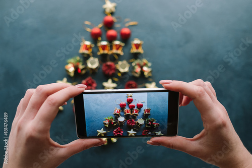 new years blog mobile photo on dark background social media holidays handmade christmas tree