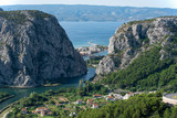 View to Omis from the mountains with the river Cetina, the town, the adriatic sea and in the background the island of Brac with a clear blue sky. - 181477870