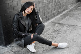 Beautiful model poses for the camera on the streets. - 181479068