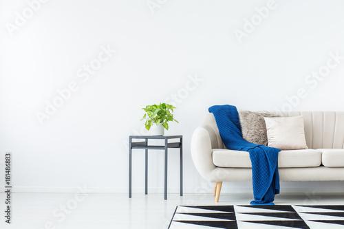 Poster Blue blanket on beige sofa