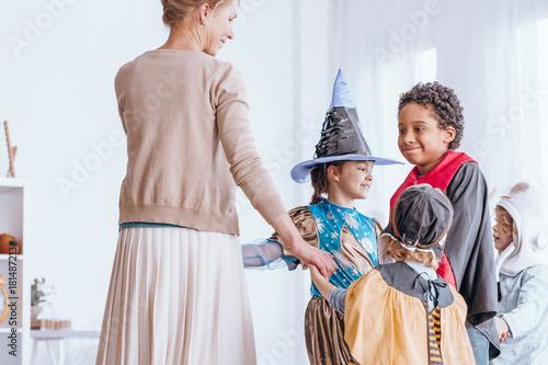 Plakát Children in costumes dancing