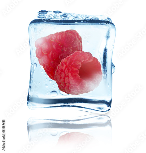 Raspberries frozen in ice cube, isolated - 181489681