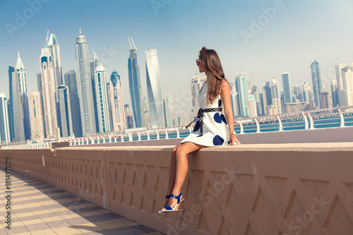 Staande foto Dubai Dubai travel tourist woman on vacation in the Palm Jumeirah