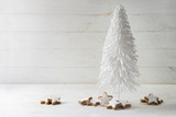 white wire christmas tree decoration and cinnamon star cookies against a rustic gray wooden background with copy space - 181503406