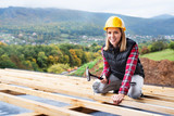 Young woman worker on the construction site. - 181505210