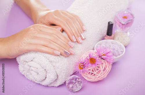Poster Manicure Beautiful pink and silver manicure with flowers and spa essentials