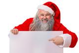 Lachender Weihnachtsmann zeigt auf Schild in der Hand
