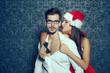 Sexy santa woman undress man at Christmas