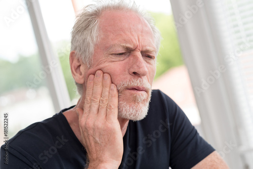Portrait of mature man with toothache
