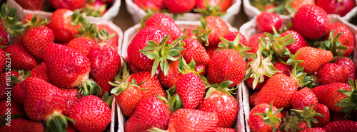 Natural strawberries in boxes at a farmers market - 181526234