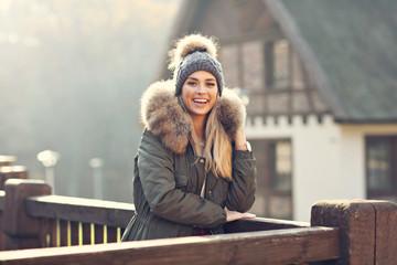 Happy woman enjoying winter season outdoors