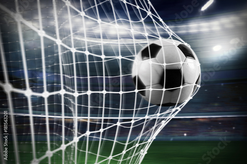 Fototapeta Soccer ball scores a goal on the net