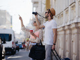 sightseeing travel. tourists take photos during their holiday. family vacation. beautiful architecture concept - 181583450