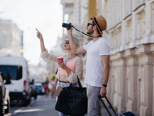sightseeing travel. tourists take photos during their holiday. family vacation. beautiful architecture concept