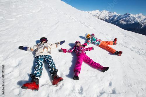 Fototapeta small children in ski resort
