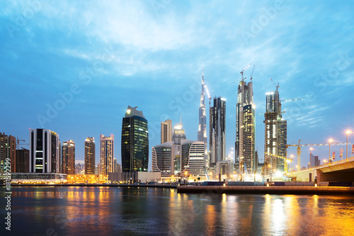 modern buildings near water at twilight Poster
