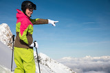 Young, sexy woman is skiing in winter paradise in the alps with a beautiful blue sky and wonderful white snowy mountains