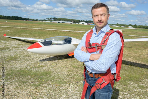 man posing with glider Poster