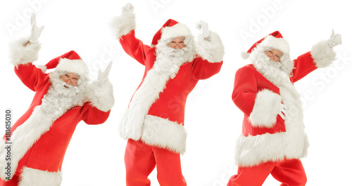 Fototapeta Santa Claus times Three, doing a happy Dance, Posing smiling and giving the Thumbs Up, Isolated on White Cut out