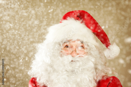 Fototapeta Portrait of Santa Claus, Excited and happy because it is Snowing