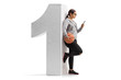 Teenage girl with a basketball and a phone leaning against a cardboard number one isolated