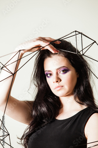 Poster Female holding model of geometric solid