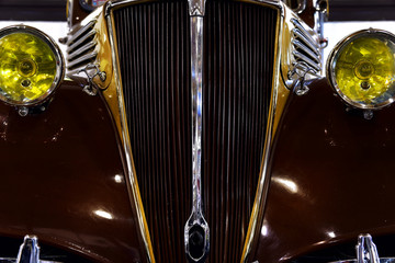 Vintage car detail with brown color. Chrome grille