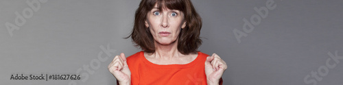 Poster surprised middle aged woman expressing misunderstanding, gray banner