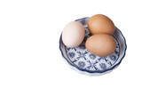 Eggs with euro coins money in basket on white. - 181628671