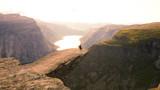 Sitting on the edge of Trolltunga in Norway.
