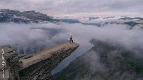 Sitting on the edge of Trolltunga in Norway in the early morning. © Jakob