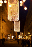 Christmas tree decoration and holidays lights on Christmas Old city street - 181630812