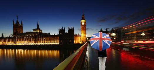 UK - Cities- Big Ben, Palace of Westminster, Tourist with Union Jack Umbrella at Westminster Bridge