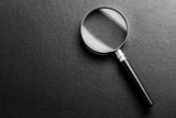 magnifying glass on  black texture  background. - 181633613