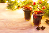 Christmas hot mulled wine with cinnamon cardamom and anise on wooden background - 181637019