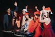 New year's party concept ,Friends party with dj  in the night  club.Group of happy young people  enjoying dancing together in nightclub