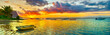 Fishing boat at sunset time. Le Morn Brabant on background. Panorama landscape
