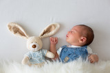 Fashionable little newborn baby boy, sleeping in the afternoon at home in bed - 181644092