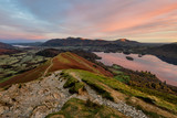 Beautiful subtle sunrise colours on a calm Autumn morning at the summit of Catbells overlooking Derwentwater in the English Lake District. - 181647040