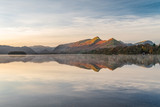 Morning golden light hitting mountains with calm reflections in lake. Taken at Derwentwater in the English Lake District. - 181649033
