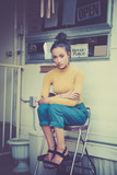 Beautiful woman sitting outside mobile home hipster retro style